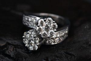 diamond ring on black background first class insurance